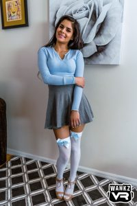 young Latina in cute skirt and white stockings