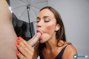 model sucking cock in photography studio